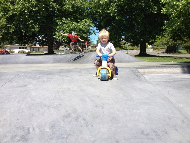 Little skateboarder with trick