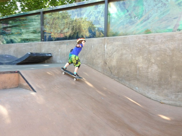 Boy skateboarding in action