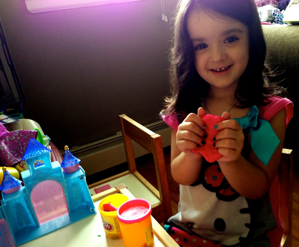 girl playing with play doh
