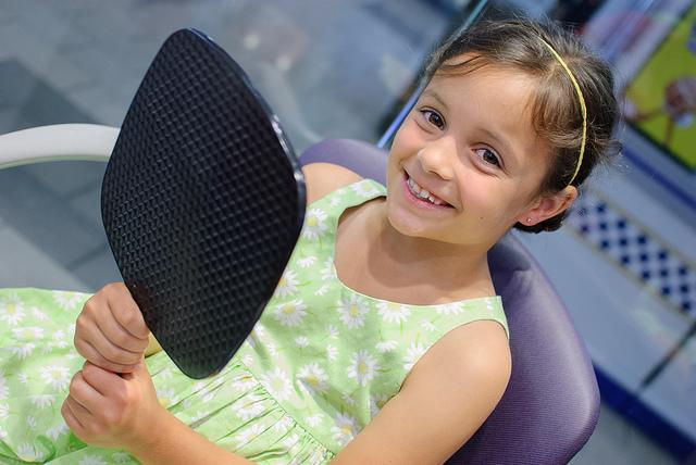 Girl With Mirror Ear Piercing