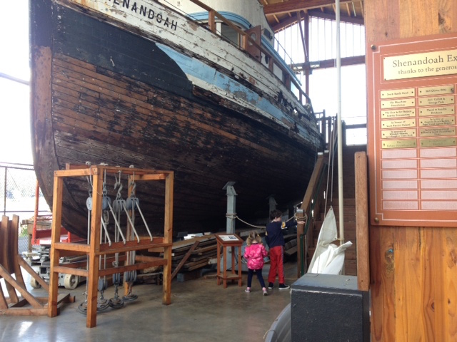 Kids by boat at Harbor History Museum