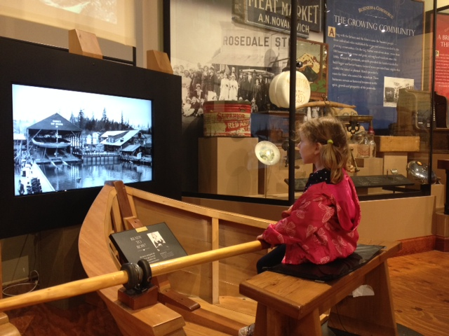 Little girl rowing harbor history museum