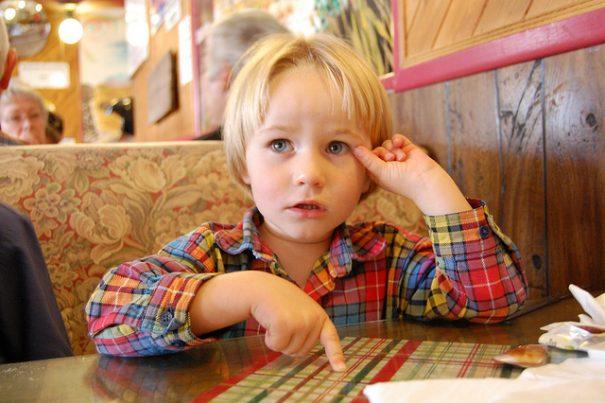 Kid eating at restaurant