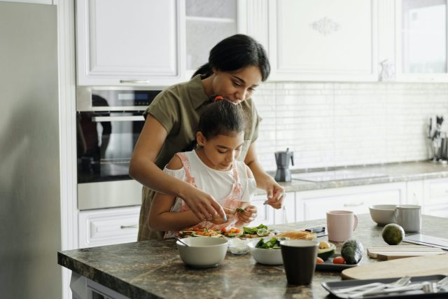 mother/daughter in kitchen